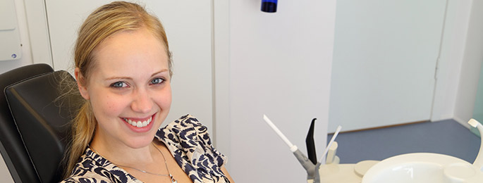 young female smiling dental office